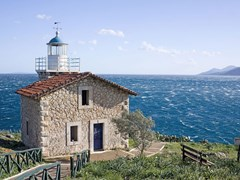 09_The-lighthouse-in-the-area-of-Astros,-Peloponnese,-Greece,-overlooking-the-Aegean-sea