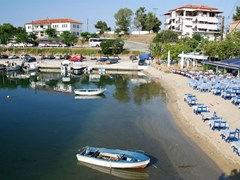 The port of the resort of Neos Marmaras in Chalkidiki, Greece, with a restaurant on the beach