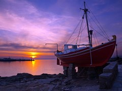 15_The-famous-red-boat-of-Mykonos-at-sunset.-Greece.