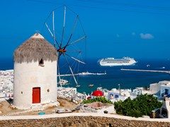 19_view-of-Mykonos,-windmill-and-old-port-with-cruise-ship